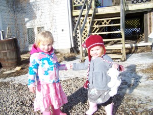 Holly loves to hold her hand; Bronwyn merely tolerates it!